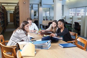 From left to right, law students Kristin Ries, Timothy Alexander, Celeste Kinney and Kendra Pruitt prepare their cases for the Life Without Parole project. Photo by Russell Cothren