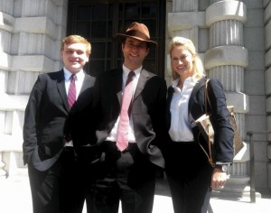 Law student Mason Boling, Professor Dustin Buehler, and law student Lauren Murphy
